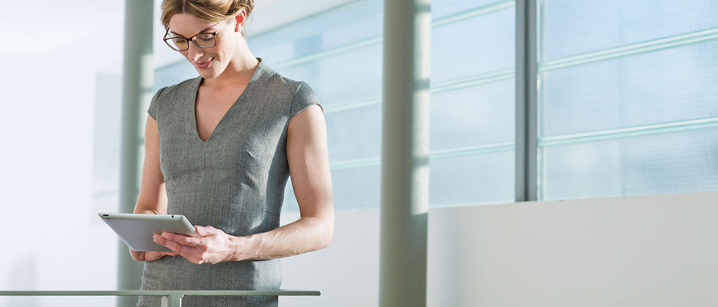 Lady-Standing-Tablet-Business-Solutions