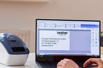 Office worker designing a label on Brother P-touch Editor label design software